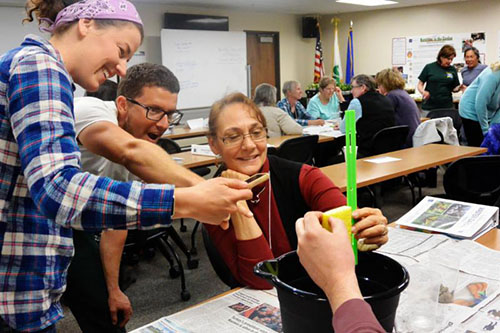 Master Gardeners doing hands-on activities in the training program