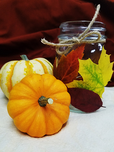 fall leaves, jar and small pumpkins