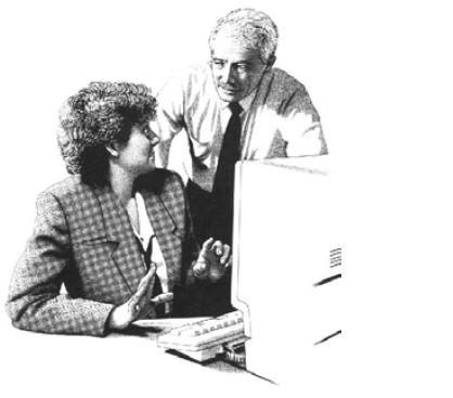 Man helping lady at computer