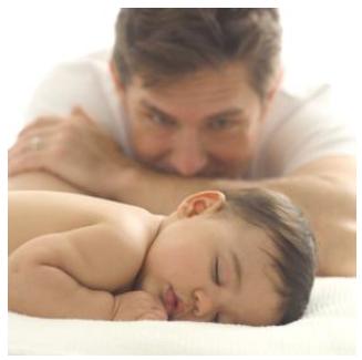 Father watching baby sleep