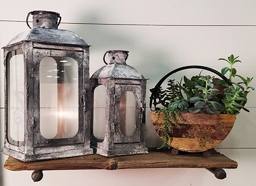 decorative lanterns and succulent potted plant