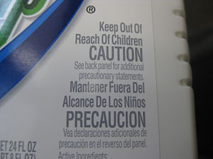 Photo of a pesticide label that says caution