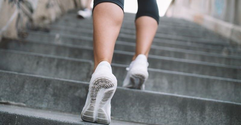 A person running up the stairs for exercise