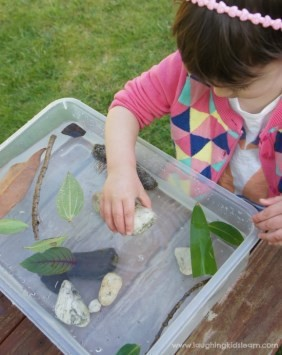Young child conducting science experiment