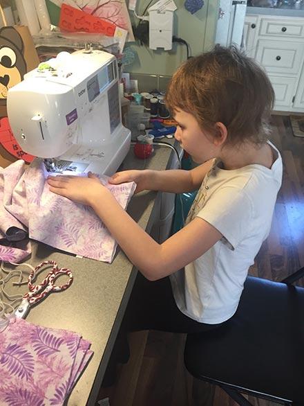 4-h member sewing mask