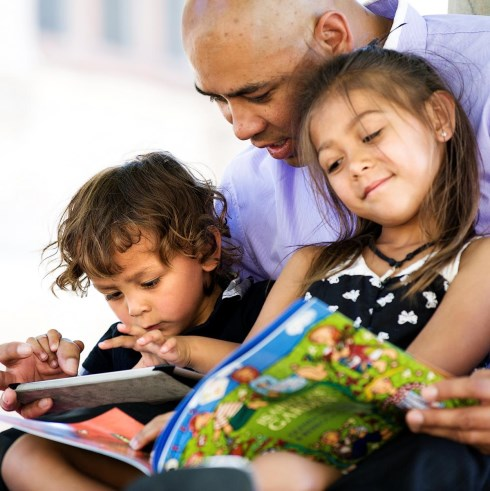 kids and parent reading together
