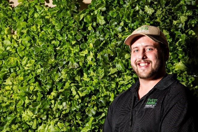 man by leafy greens