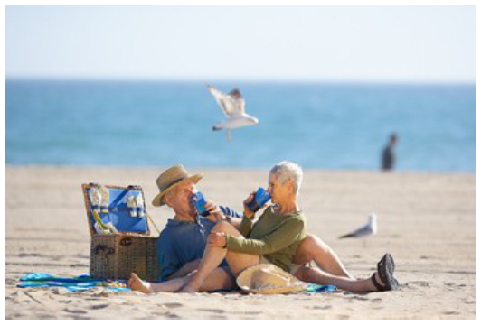 Old couple relaxing at beach