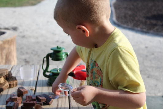young child conducting a science experiment