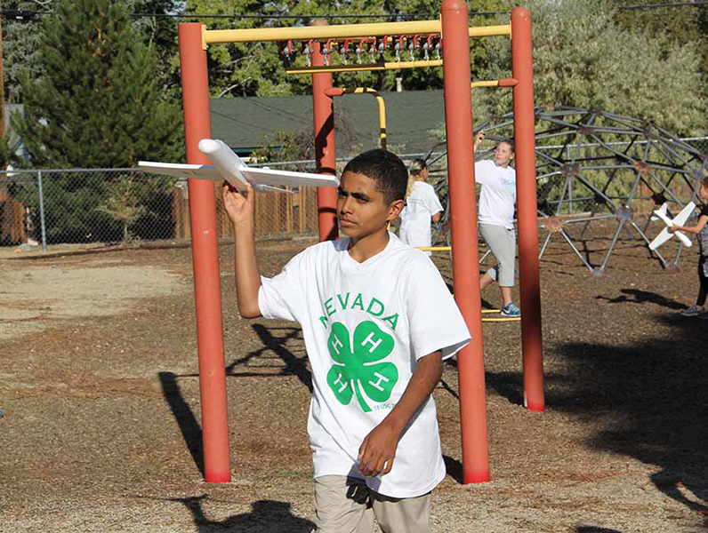 4-H student holding their drone