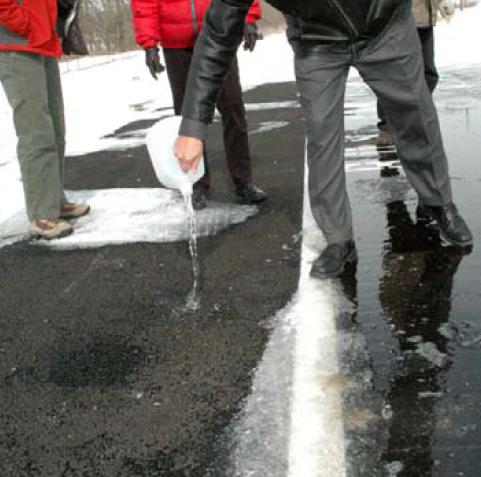 People testing porous asphalt