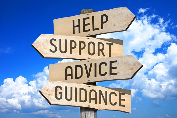 Sign with four arrow posts that say help, support, advice, guidance.