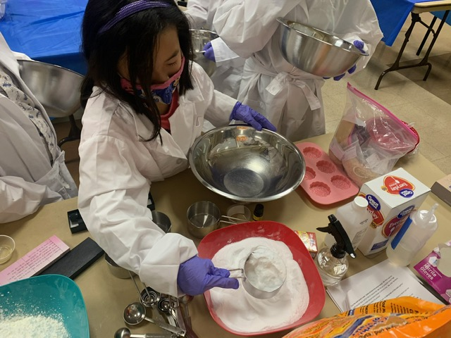 Young girl make soap using house hold ingredients.