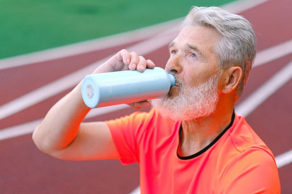 Older adult drinking water