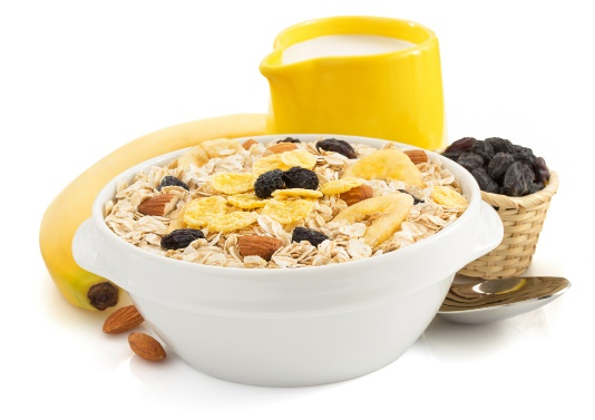Bowl of oatmeal with fruit and nuts