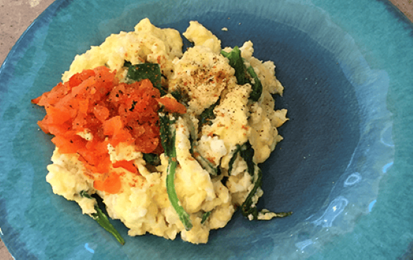Scrambled eggs with red bell pepper and spinach.