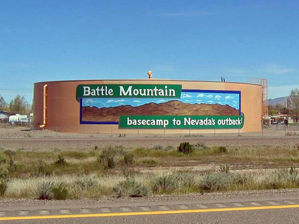 battle mountain basecamp to Nevada's outback sign on a water tank.