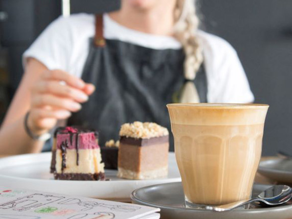 Lady serving cakes and coffee