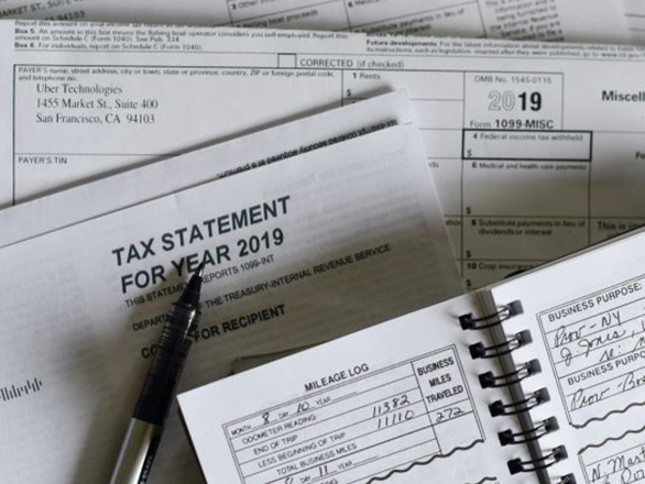 Several tax forms and a day planner