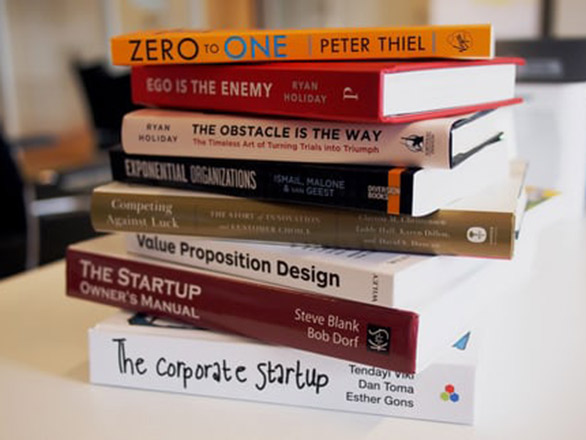 Stack of books about Starting Up a Business